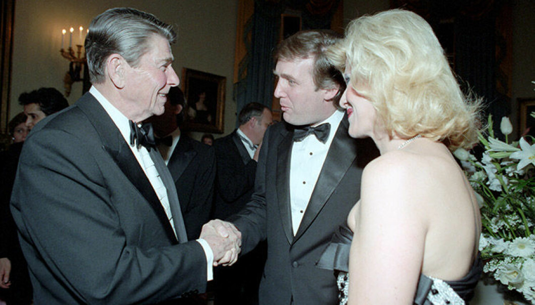 2/11/1985 President Reagan shaking hands with Donald Trump and Ivana trump during the State Visit of King Fahd of Saudi Arabia at the state dinner in the Blue Room