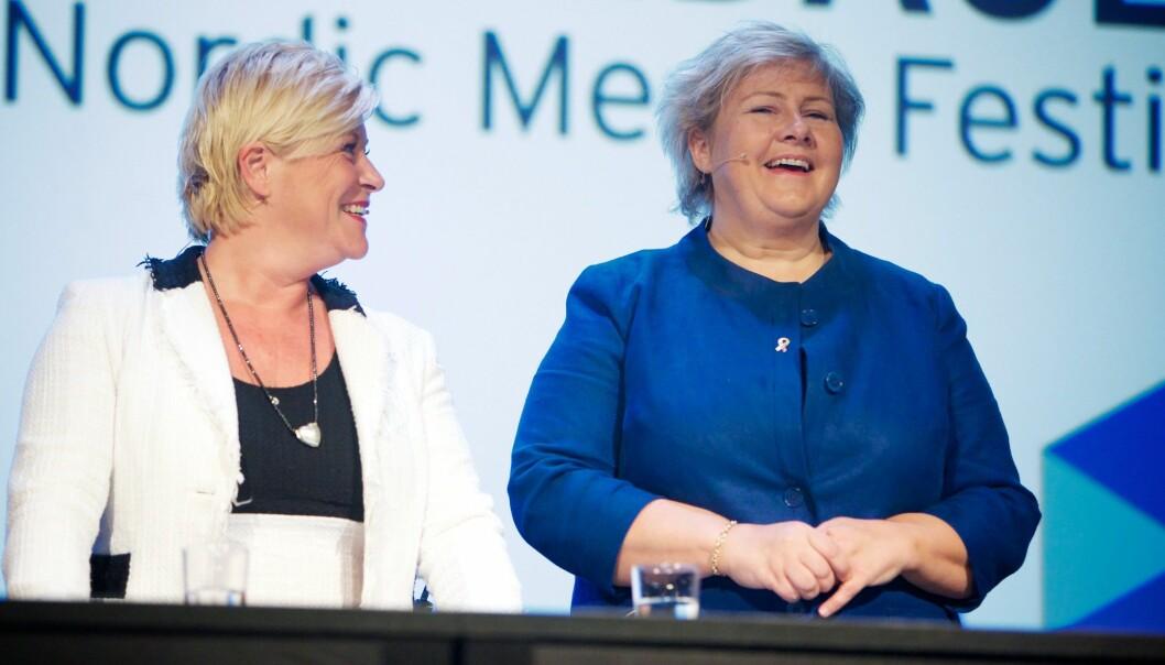 Siv Jensen og Erna Solberg.